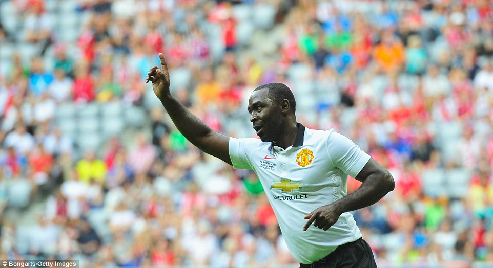 Still got it: Andrew Cole celebrates his brilliant backheeled opener for Manchester United against Bayern Munich at the Allianz Arena