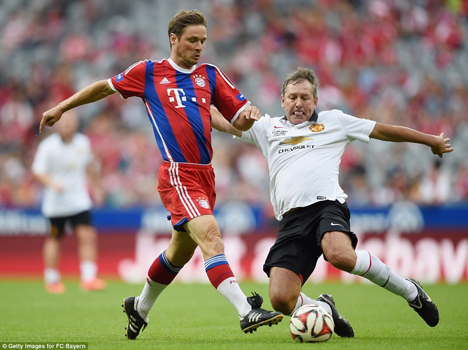 Hero: Bryan Robson was player-manager of United and wasn't afraid to go in for this meaty challenge on Bayern's Harald Cerny late in the game