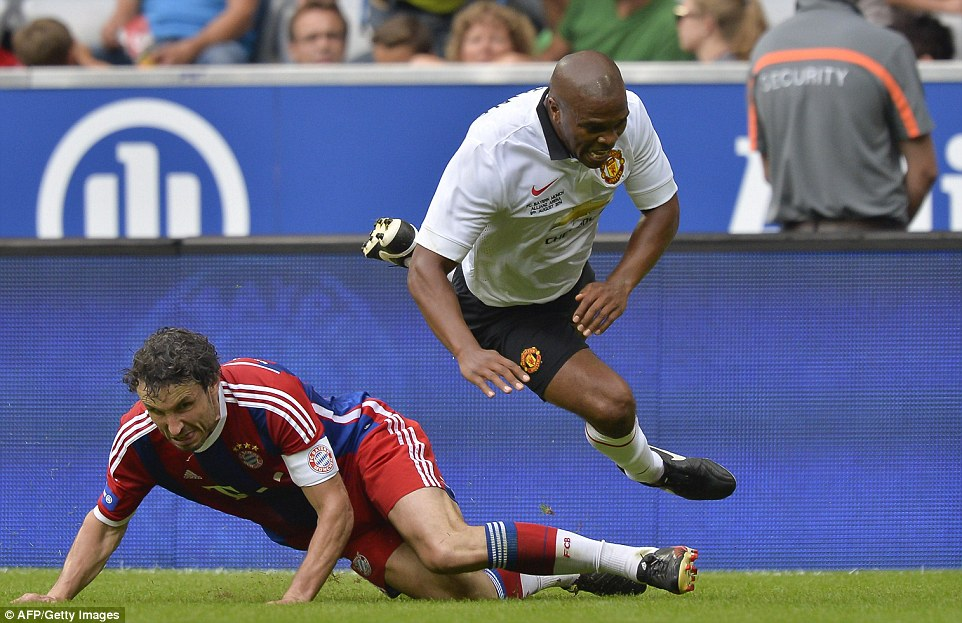 Not so friendly! Notorious tough tackler and Bayern captain for the day Mark van Bommel fouls United's Quinton Fortune as he tries to make a breakaway from midfield
