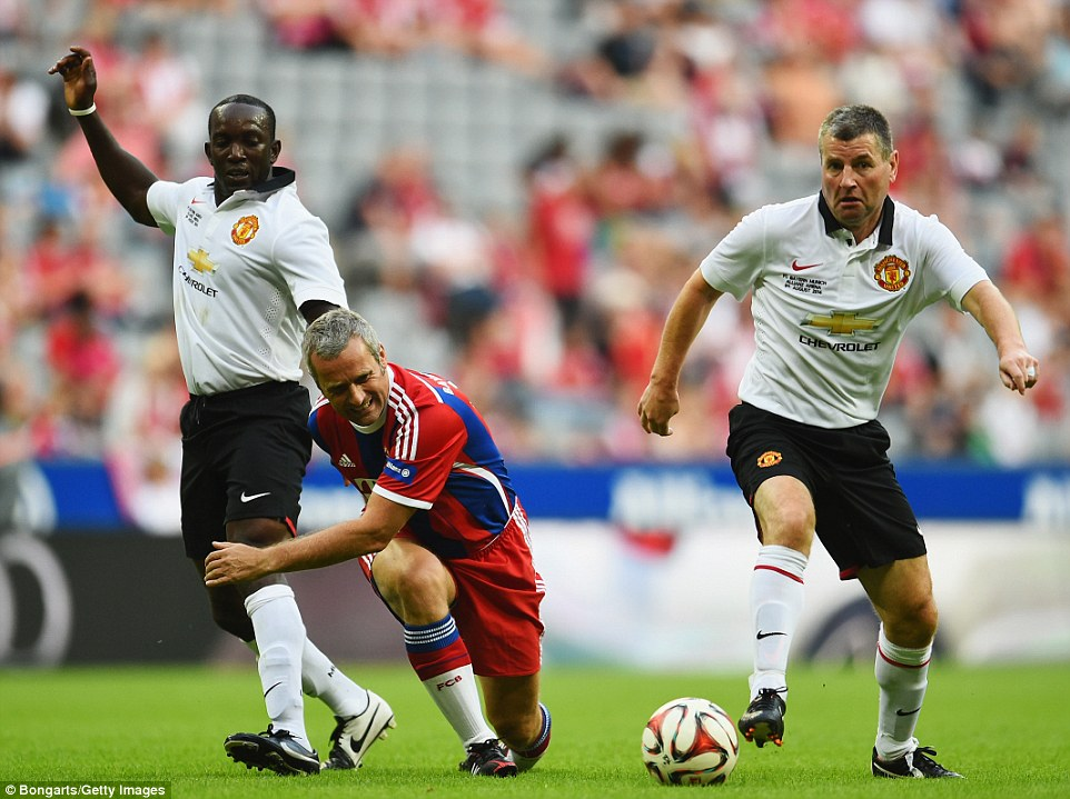 Quality: Denis Irwin comes away with the ball after a Yorke challenge on Markus Schupp who looks to be struggling with the rigours of the game