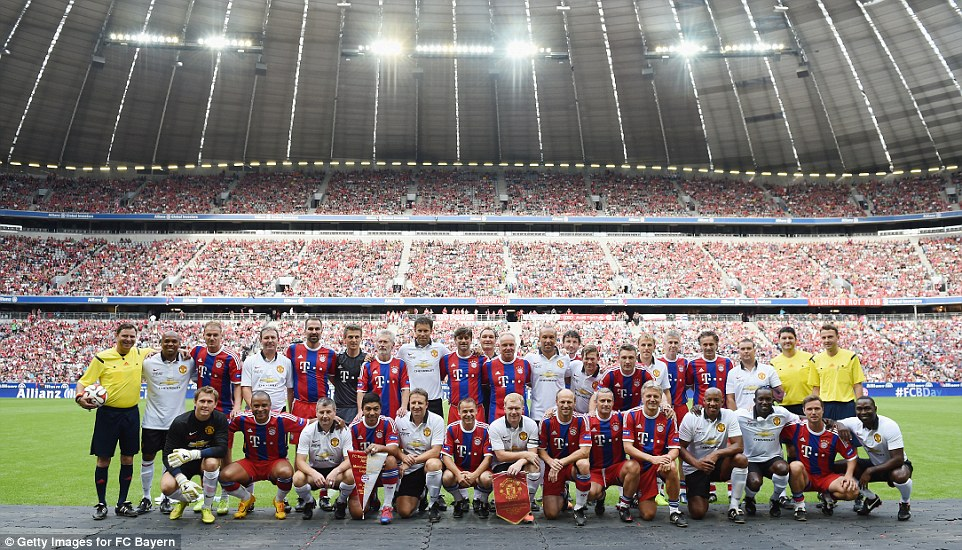 Familiar faces: The legends from both sides pose for a photograph ahead of the game at a busy Allianz Arena on Saturday