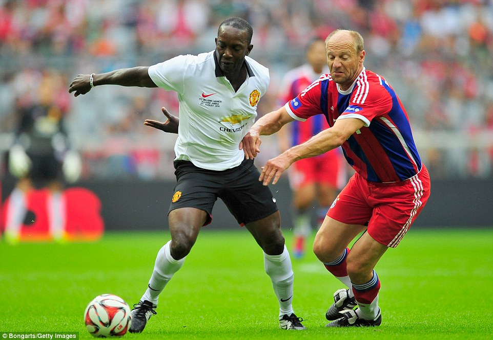 Touch of class: Dwight Yorke takes the ball away from Hans Pflueger on the perfect turf at Bayern's brilliant home ground