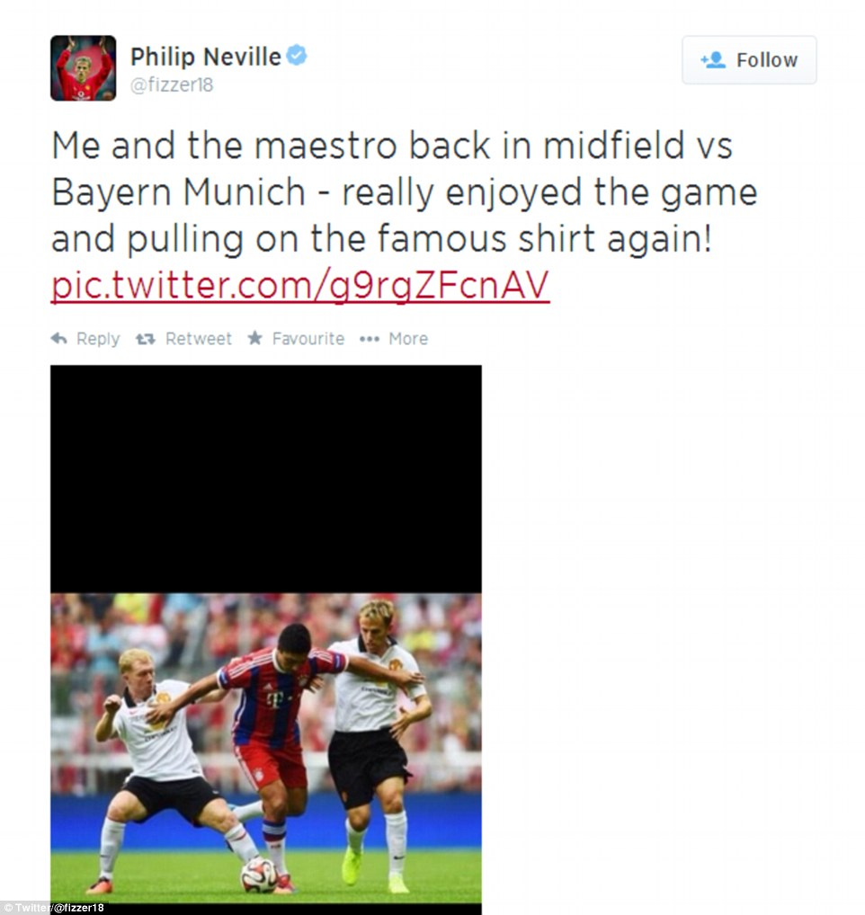 Maestro: Phil Neville was glad to be back alongside Scholes in a United shirt for the first time in many years as they took on the Bayern Munich XI