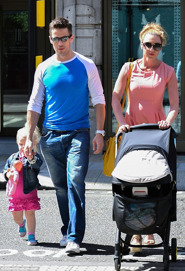 Picture perfect: The family stepped out in Great Portland Street, just behind Oxford Street