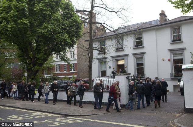 Popular: Beatles fans are pictured queueing to go into Abbey Road Studios in St John's Wood yesterday