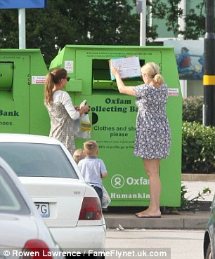 Charitable: The star was throwing away what appeared to be a pair of shoes