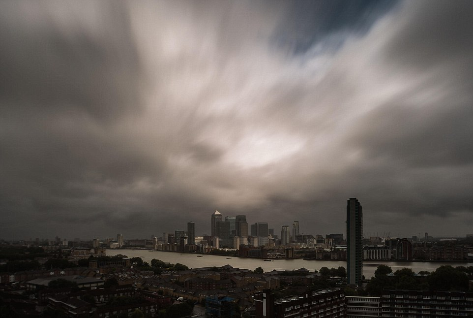 Looming: Hurricane Bertha brings heavy wind and rain storms over London. Heavy rain and winds will sweep through the UK as a consequence of the dying moments of the storm, which brought chaos to the Caribbean