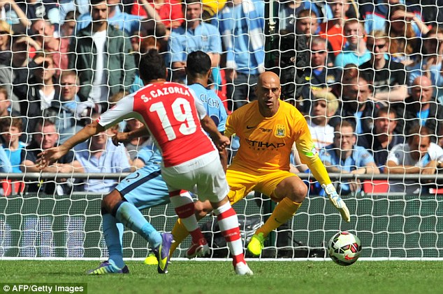 Skipping in: Goalkeeper Willy Caballero could do nothing as Santi Cazorla put Arsenal ahead against City