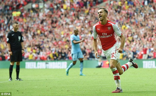 Celebrate: Ramsey enjoyed scoring at Wembley again and looks in good form for the new season
