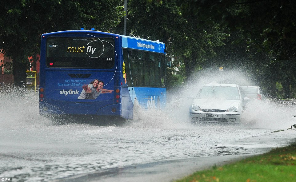 Vehicles pass through a flooded road in Chilwell, Nottingham, as the remnants of Hurricane Bertha passes through the East Midlands. PRESS ASSOCIATION Photo. Picture date: Sunday August 10, 2014. The former hurricane tore through the Caribbean early last week and has travelled over the Atlantic to the UK, bringing the threat of floods in its wake. See PA story WEATHER Rain. Photo credit should read: PA Wire