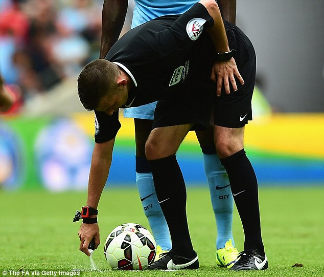 Magic spray: Michael Oliver uses the vanishing spray for the first time in English football