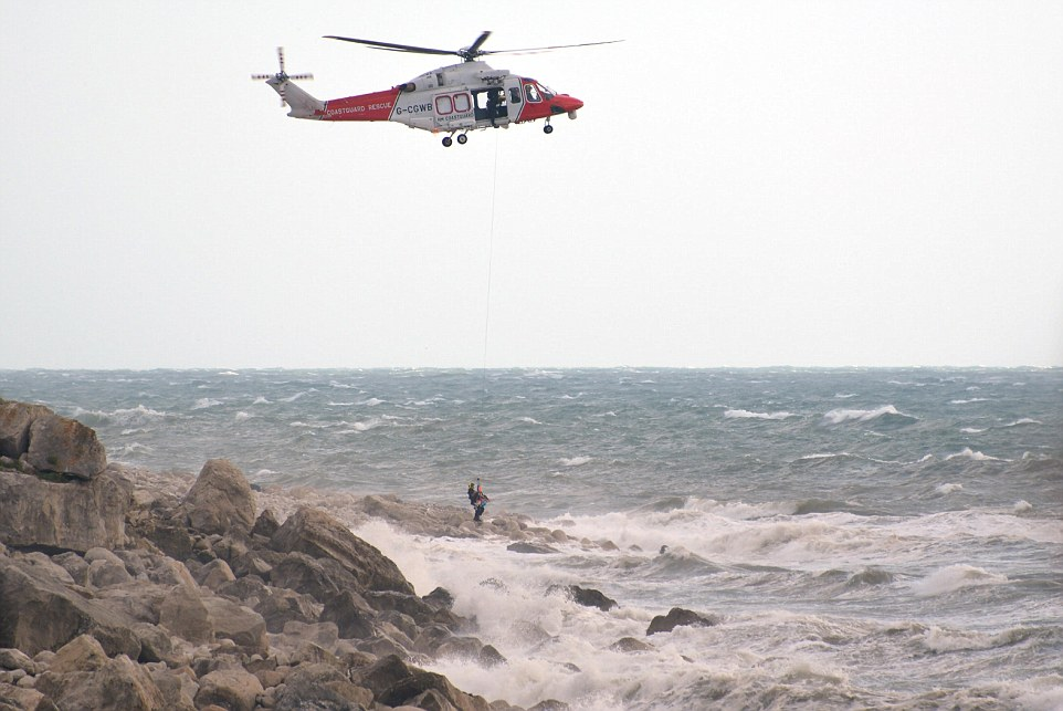 Help arrives: A rescue took place at Chiswell Cove in Portland, Dorset in stormy weather yesterday afternoon at about 6pm