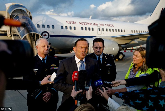 Prime Minister Tony Abbott speaks to the press upon arrival at the Airport in Rotterdam, The Netherlands