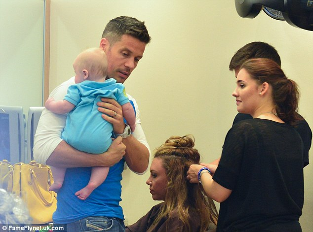 Feeling broody? The stylist snuck a longing look at baby AJ during Michelle's pampering session