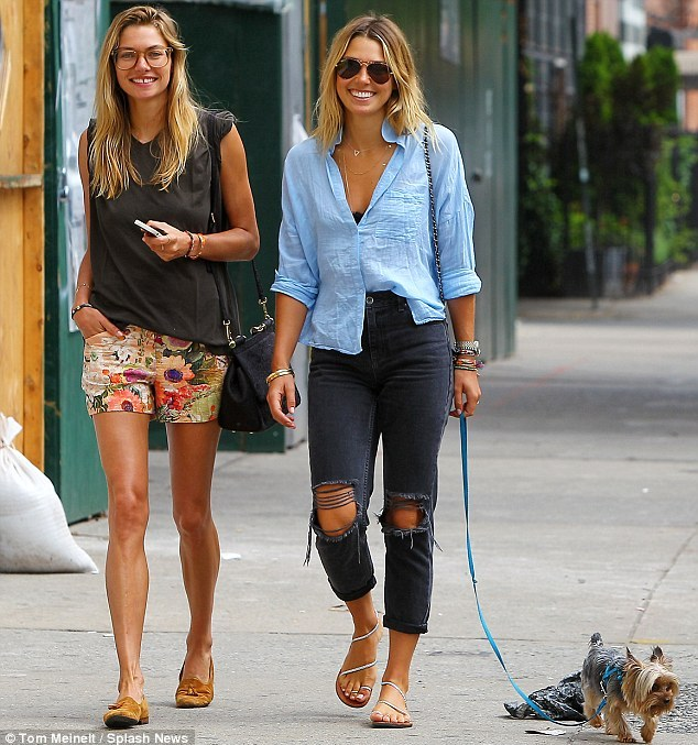 Genetically blessed: The model duo were recently seen walking Ashley's pet pooch, a terrier cross,  in New York