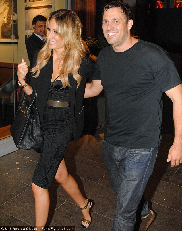 Giggles: The couple couldn't wipe the smiles from their faces as they left Neighbour  bar and restaurant