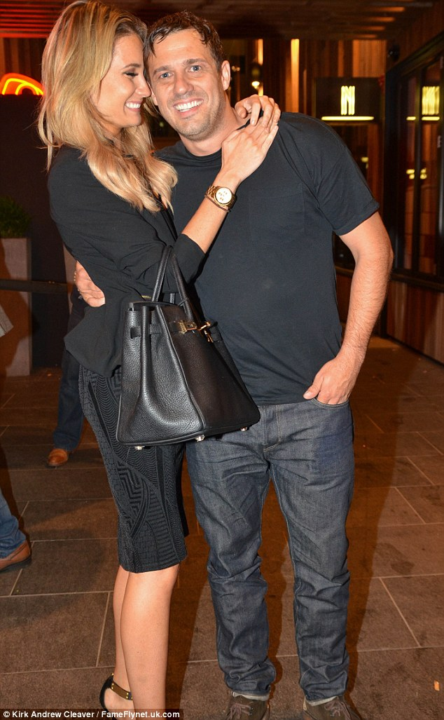 Loved up: Chloe, who has been dating the actor since January, wrapped her arms around him