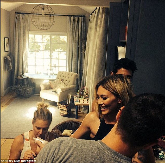 Beauty is work: Hilary Duff captioned this Sunday photo, 'Yes it really took this many people... @marcusrfrancis @adambreuchaud @anitapatrickson I'm ready for the @TCAs_2014'