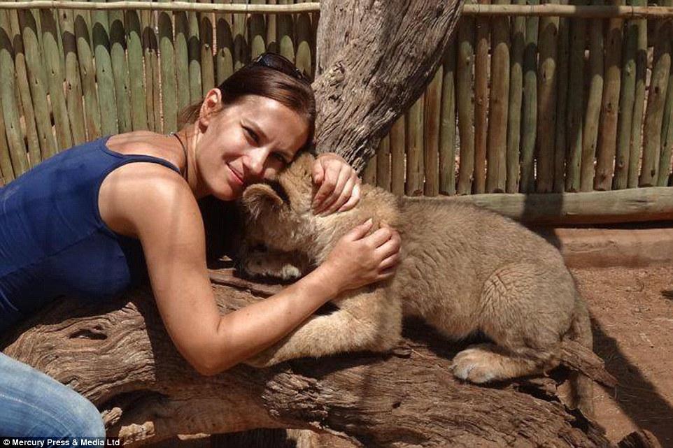 A rare bond: Polish journalist Goska Zdziechowska decided she wanted to help wild animals during a holiday to Thailand
