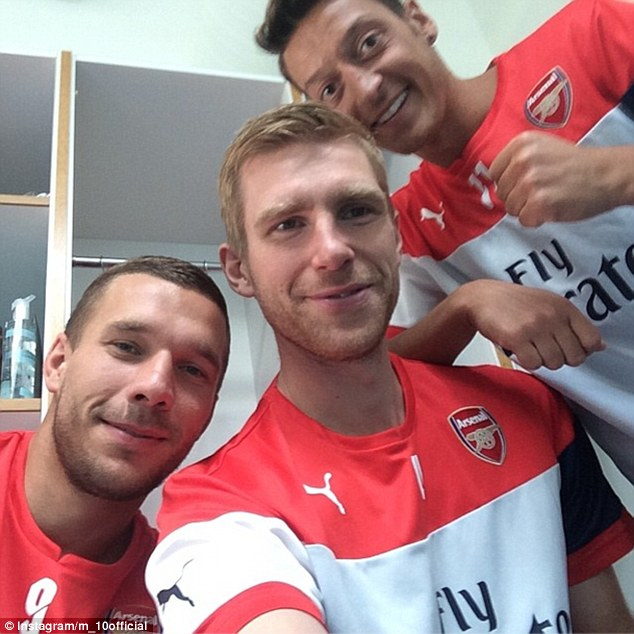 They're back! German World Cup-winning trio (left to right) Lukas Podolski, Per Mertesacker and Mesut Ozil posted a photo on Instagram in their Arsenal training kit, revealing they are ready for the new season