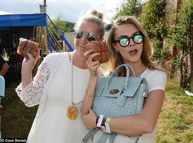 Cool Cara: Miss Delevingne was kitted out in Mulberry gear but added her own quirky spin to her outfit with the help of some novelty specs