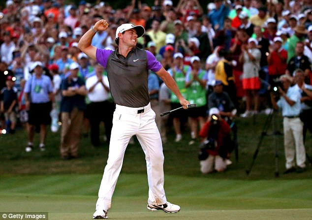 Unbridled joy: McIlroy celebrating in near-darkness the moment he won at Valhalla