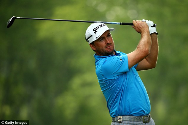 Backing: Graeme McDowell has faith that McIlroy can catch the likes of Jack Nicklaus and Tiger Woods