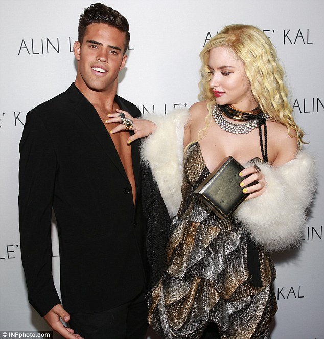 Checking out the eye candy! Gabi couldn't resist touching a very tanned male model at a party for designer Alin Le'Kal in Melbourne last week