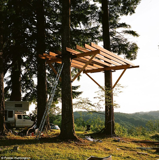 New plan: After years of driving and traveling, Huntington is now pulling up in the woods of Oregon - where he grew up - to build a tree house