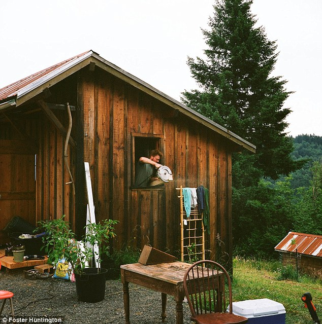 This cabin has already been built to live in while the tree house goes up