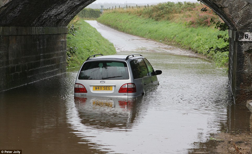 In Scotland, motorists were warned to expect disruption as flood warnings were put in place across the country. The warnings cover Aberdeenshire, Caithness and Sutherland, Findhorn and Nairn, Moray, Tayside and Spayside. PictureD: A car trapped in flood water in Elgin