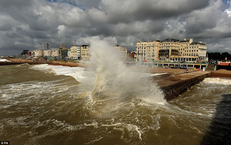 As the low pressure system that formed from the remnants of Bertha sits in the North Sea, the Met Office also said it would also be 'unseasonably breezy' over the next few days, helping to create these huge waves seen on Brighton beach