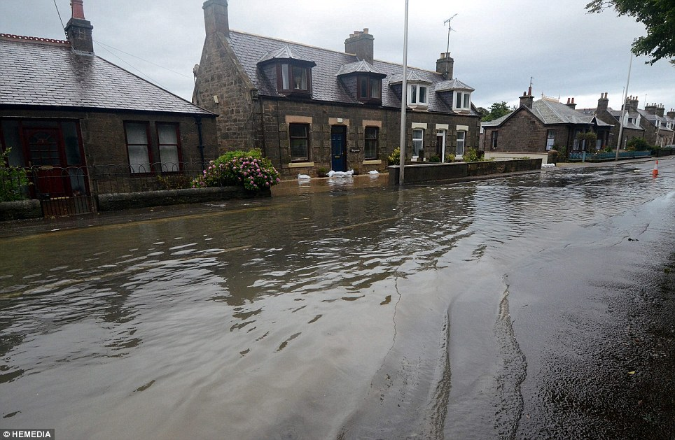Flooded roads resembled waterways this morning as some areas of Scotland recorded more rain overnight than they do usually in an entire month