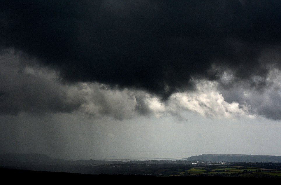 The clouds are the first sign of a gloomy week of weather which forecasters predict will hang over Britain until Friday