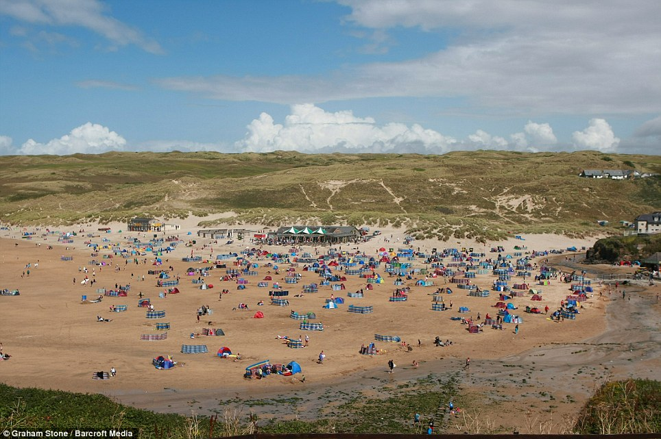 It wasn't all bad: People enjoy the weather at the Perranporth beach, south of Newquay in Cornwall