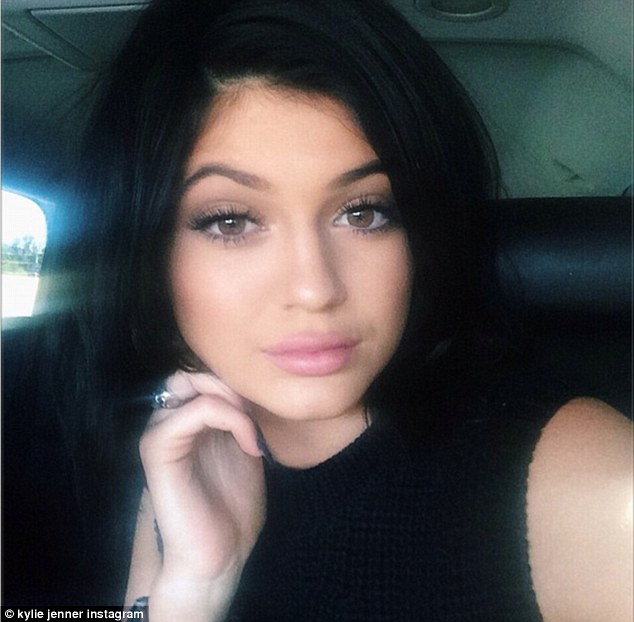 She's there too: Kylie Jenner, whose 17th birthday is Sunday, added this shot with the caption, 'Blurry bday pic on my way to teen choice'
