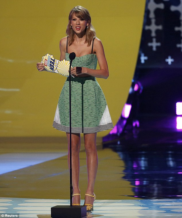 'No-one knows dramatic males more than I do!' Taylor Swift had a giggle as she presented Choice Movie Actor In A Drama award to Ansel Elgort, while she herself picked up the Choice Female Country Artist gong