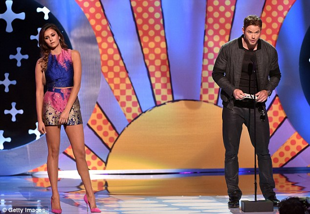 'I know you're dating five guys right now. I know I'm Expendable and I can handle four guys, but five!' Kllan Lutz made fun of the constant relationship rumours surrounding co-presenter Nina Dobrev as they took to the stage together, refusing to stand too close to her