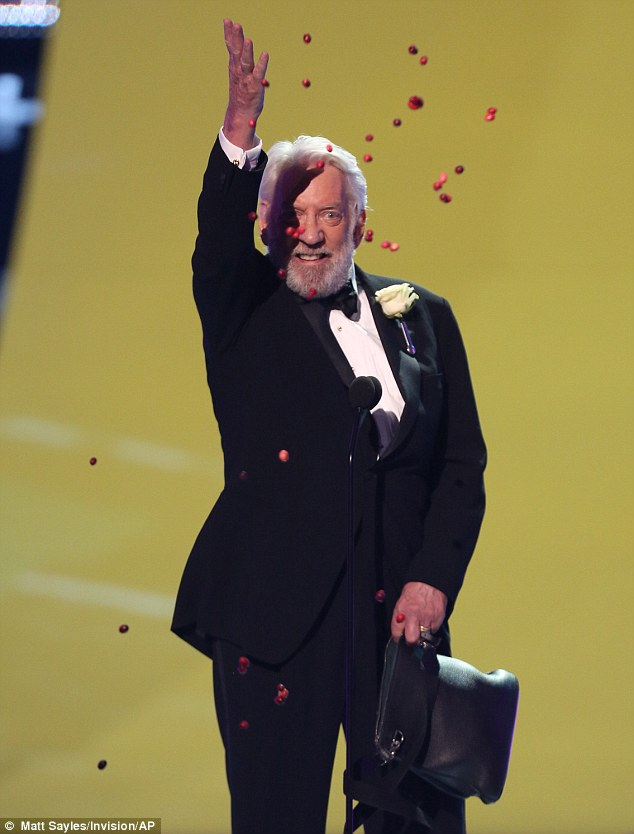 Young at heart: Donald Sutherland rather oddly showered the front row with suspicious berries that he suggested they not eat after scoring the Choice Movie Villain gong for The Hunger Games: Catching Fire