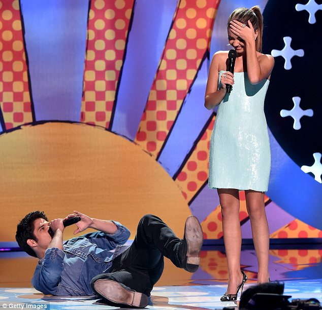 Goofing around: The hosts kicked things off with a bang, which meant Tyler was rolling around on the floor