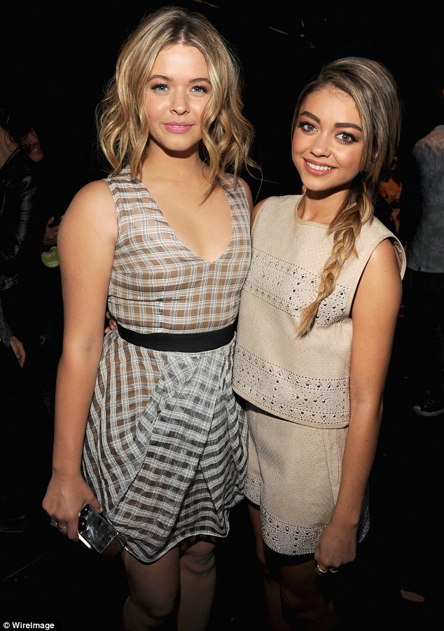 Braided beauty: Sarah wore her hair in a plait for this look, and was pictured posing with Sasha Pieterse