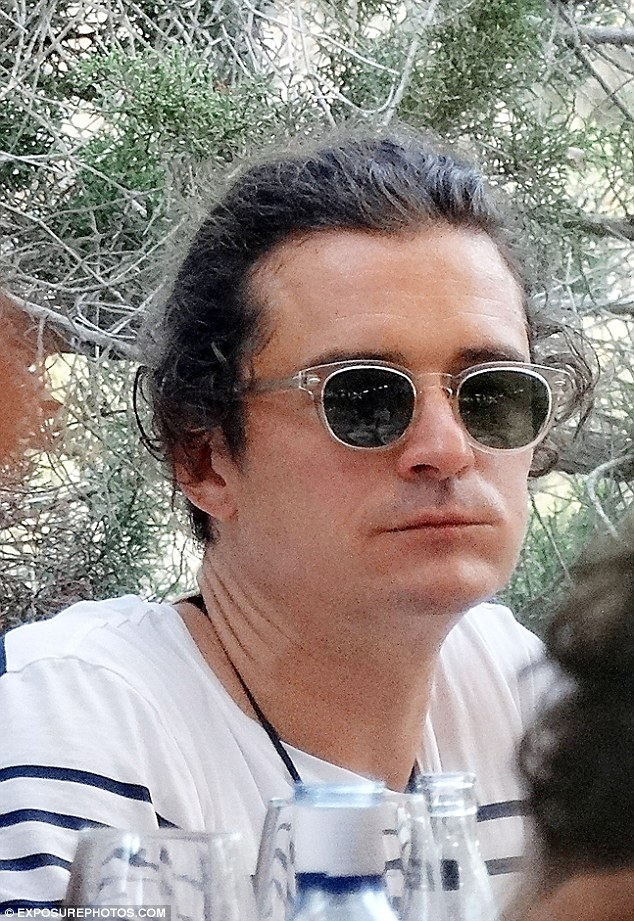 Lunching with pals: The handsome 37-year-old enjoyed an extended lunch in the sun with his chums