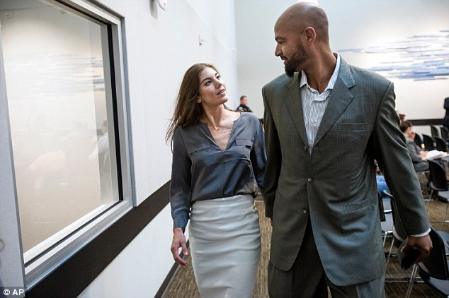 Facing the charges together: Soccer player Hope Solo (left) and her husband Jerramy Stevens (right), a former pro-football player, appeared in court on Monday for another hearing regarding assault charges against Solo