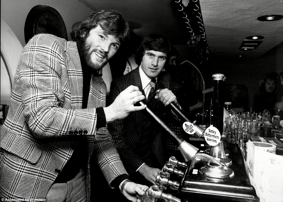 Footballers Eddie Gray (L) and Peter Lorimer pulling pints at the opening of their new pub in Leeds, the Brahms and Liszt