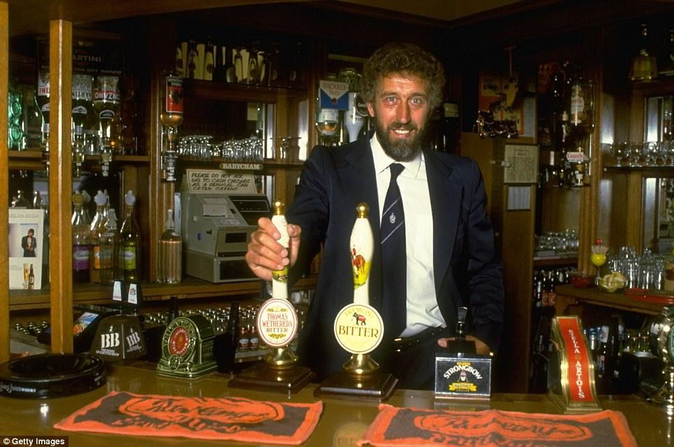 Former Spurs star Martin Chivers behind the bar