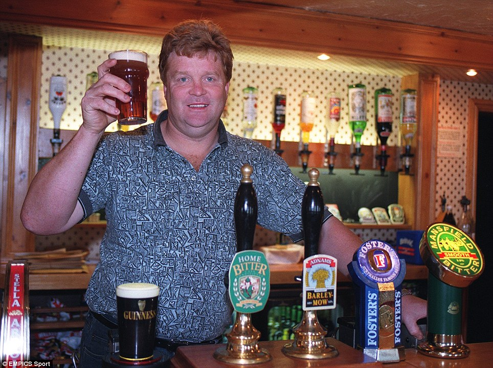 Former footballer Willie Young pulling pints behind the bar of his pub, The Bramcote Manor, in Nottingham