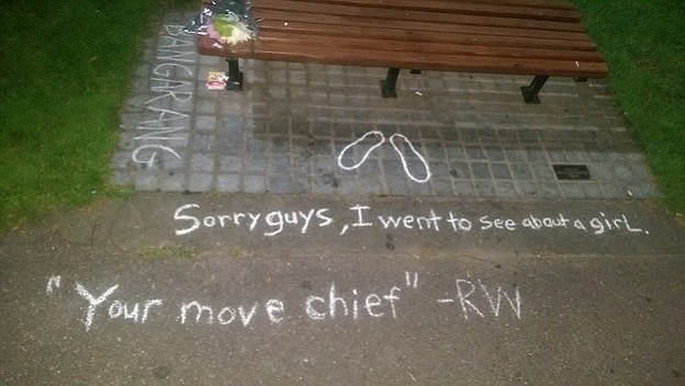 Tribute: Quotes from Williams' career have been chalked around the bench and flowers placed at the site