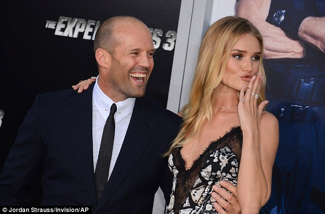 Cute couple: Rosie laughed and joked with her man Jason Statham, 47,  as she hit the red carpet on his arm