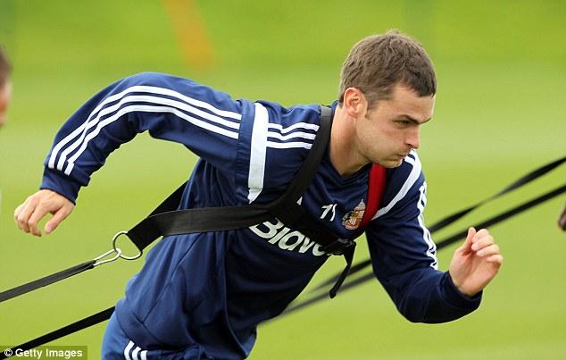 Tough going: Sunderland wideman Adam Johnson does his best to proceed forward