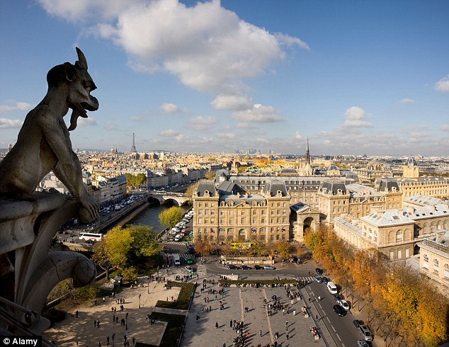 A stony look: Paris observed from the top of Notre Dame with La Tour Eiffel in the distance